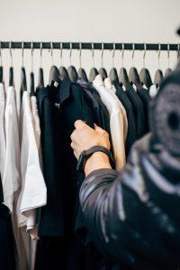 wood hangers in walk-in closet