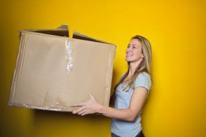 woman moving boxes into new home